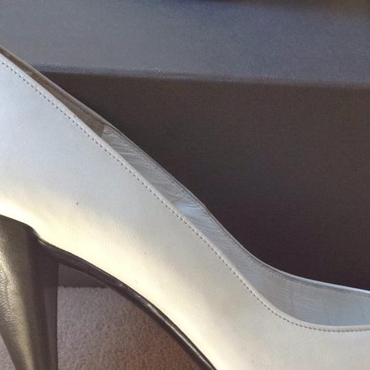 Charles Jourdan White Pumps