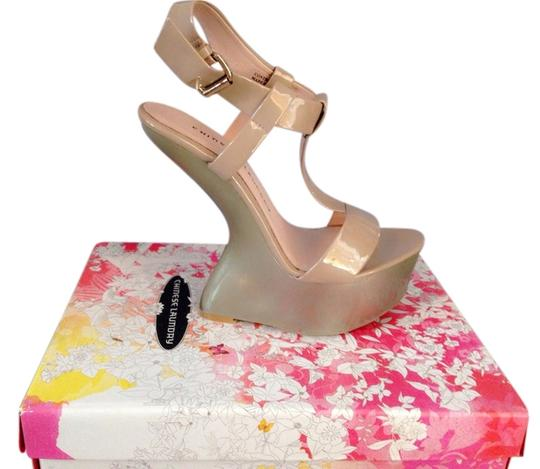 Preload https://item3.tradesy.com/images/chinese-laundry-patent-nude-wedges-3397762-0-0.jpg?width=440&height=440