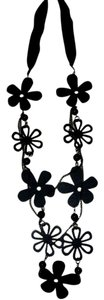 Other Black fashion accessory with wood flower details