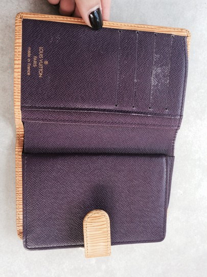 Louis Vuitton Yellow with purple interior Clutch