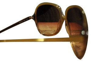 Preload https://item1.tradesy.com/images/oliver-peoples-gold-and-amber-62-15-130-soflane-sunglasses-3413620-0-0.jpg?width=440&height=440