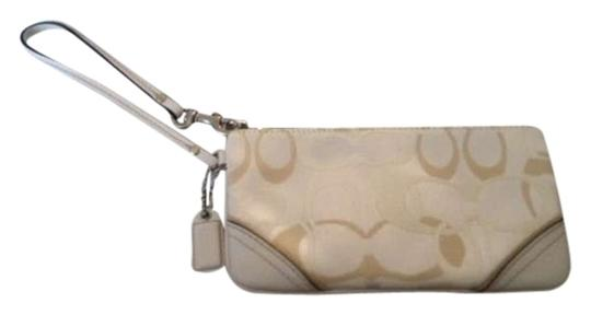 Preload https://img-static.tradesy.com/item/341859/coach-white-and-gold-canvasleather-wristlet-0-0-540-540.jpg
