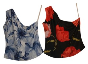 Expressions One Shoulder Floral Sleeveless Machine Washable Comfortable Breathable Soft Top White and multiple shades of blue as well as a Black, Red and Green Top