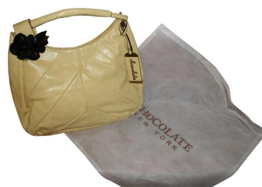 Preload https://img-static.tradesy.com/item/3428083/chocolate-handbags-new-yorkhobo-with-a-peek-a-boo-black-rose-accent-yellow-faux-leather-hobo-bag-0-0-540-540.jpg