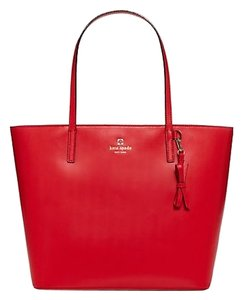 Kate Spade New With Tags Attached Zip Top Closure Interior Zip Pocket And 2 Slide Pockets Removable Leather Bow Key Fob Tote in Lacquer Red