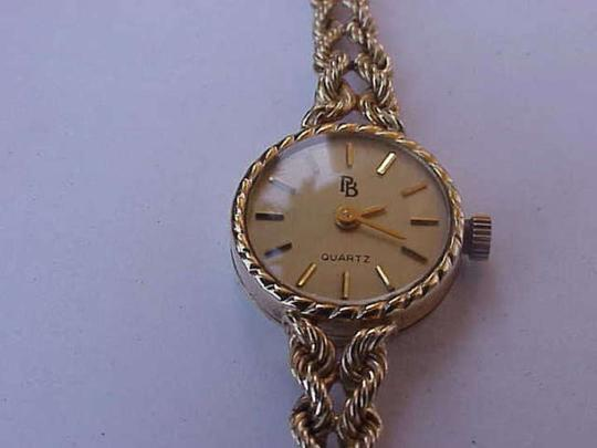 Vintage 14k yellow gold quartz watch