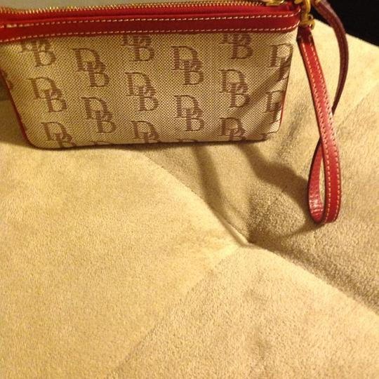 Dooney & Bourke Wristlet in Light Brown