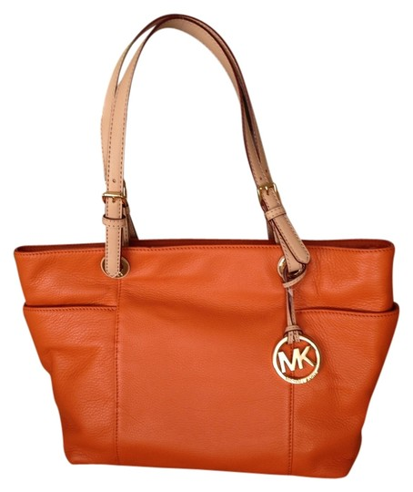 Preload https://item5.tradesy.com/images/michael-kors-orange-jet-set-leather-tote-3458599-0-0.jpg?width=440&height=440