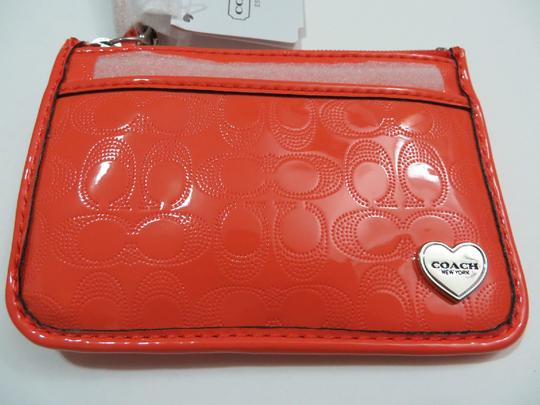 Coach Coach PERFORATED EMBOSSED LIQUID GLOSS ID SKINNY CARD CASE Coach Card Wallet (Ship Via Priority Mail)