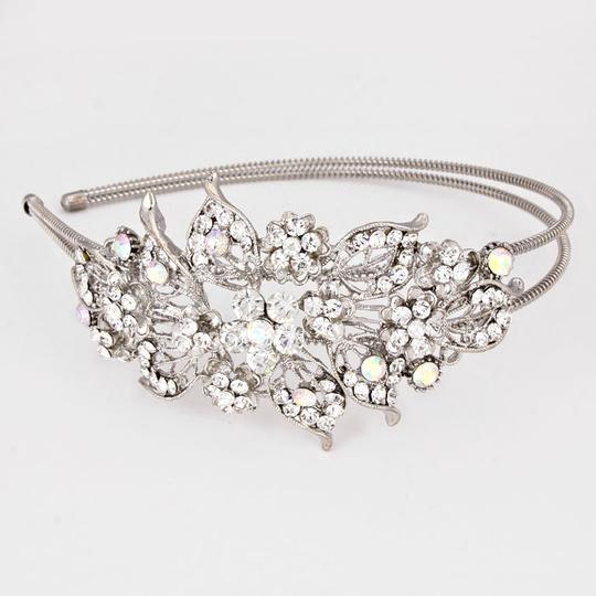 Preload https://item5.tradesy.com/images/silverrhodium-crystal-ab-bedazzling-rhinestone-flower-accent-headband-party-hair-accessory-3464044-0-0.jpg?width=440&height=440