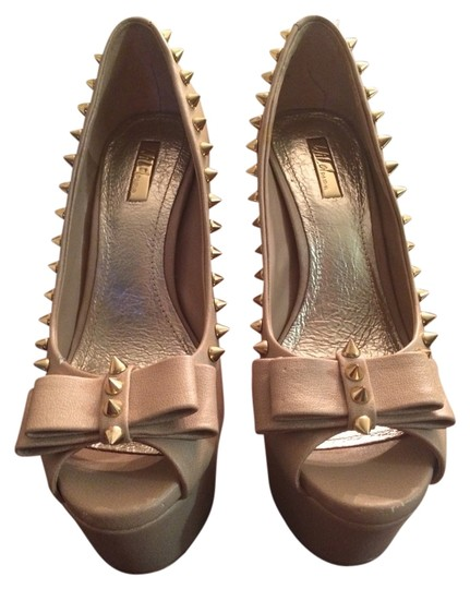 Preload https://item5.tradesy.com/images/bakers-nude-with-spikes-sandals-3466924-0-0.jpg?width=440&height=440