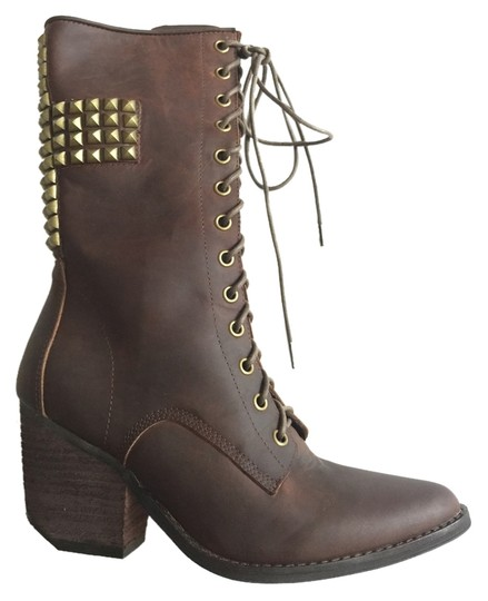 Preload https://item4.tradesy.com/images/jeffrey-campbell-brown-holly-roller-657758859-bootsbooties-size-us-65-regular-m-b-3467593-0-0.jpg?width=440&height=440