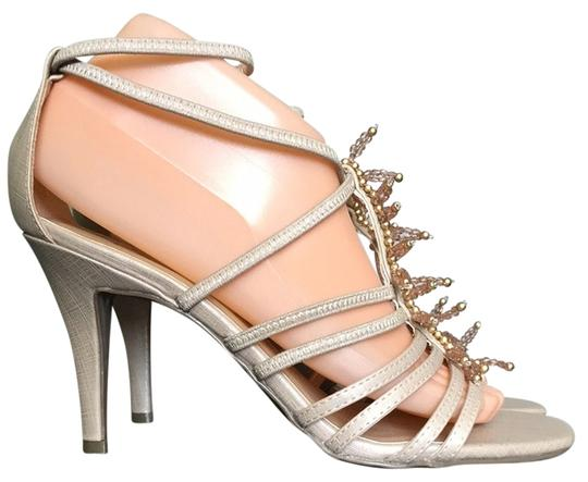 Preload https://item2.tradesy.com/images/champagne-c21917197-strappy-high-heel-formal-shoes-size-us-8-regular-m-b-3476386-0-0.jpg?width=440&height=440