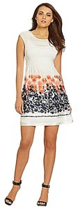 M.S.S.P. short dress Navy,Coral,White Floral Pleated Multicolred Print Capsleeves on Tradesy