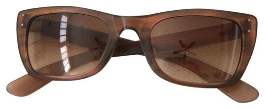 Preload https://item3.tradesy.com/images/ray-ban-brown-caribbean-rb4148-prescription-sunglasses-3481147-0-0.jpg?width=440&height=440