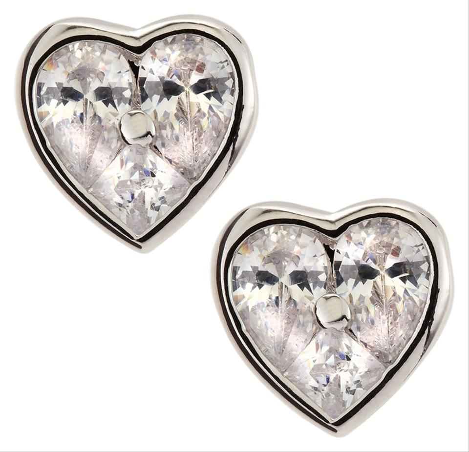 earrings pair of diamond stud shaped heart and a ruby image
