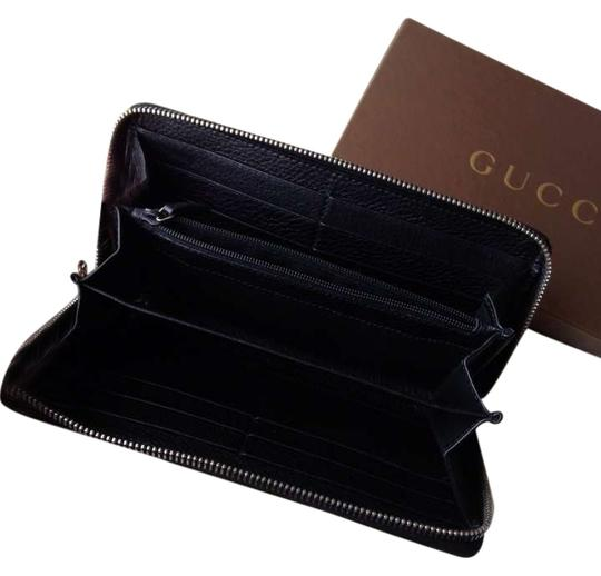 Preload https://img-static.tradesy.com/item/348284/gucci-black-zippy-wallet-0-0-540-540.jpg