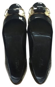 Gucci Black & Gold Flats