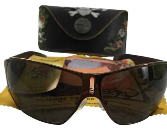Preload https://item1.tradesy.com/images/ed-hardy-brown-with-bronze-meth-a-frame-leather-sides-sunglasses-3487225-0-0.jpg?width=440&height=440