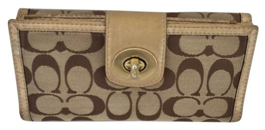 Preload https://item4.tradesy.com/images/coach-brown-turn-lock-with-checkbook-gold-wallet-3500488-0-4.jpg?width=440&height=440