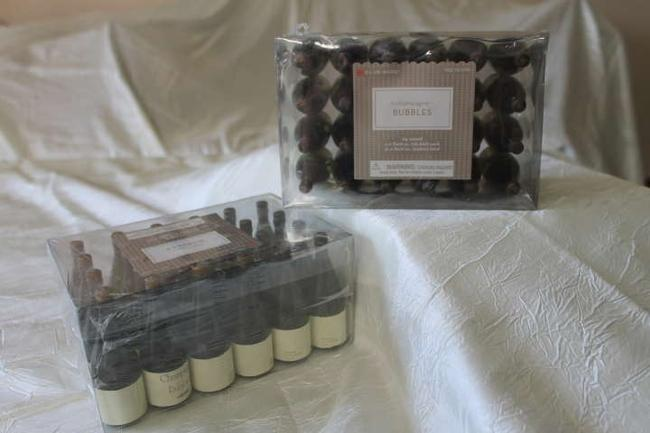 Item - 2 Boxes Of 24 Champagne Bubbles