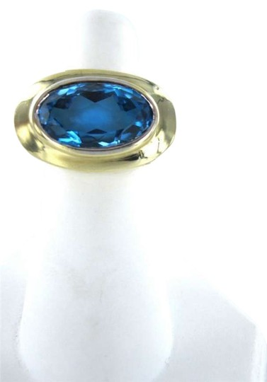 Preload https://item1.tradesy.com/images/yellow-gold-14k-blue-topaz-76dwt-6-oval-big-celebrity-look-ring-351560-0-0.jpg?width=440&height=440