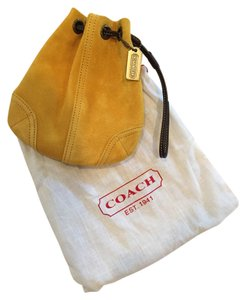 Coach Wristlet in Mustard Yellow