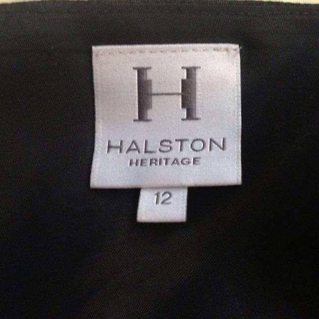 Preload https://item2.tradesy.com/images/halston-black-asymmetrical-above-knee-cocktail-dress-size-12-l-358301-0-0.jpg?width=400&height=650