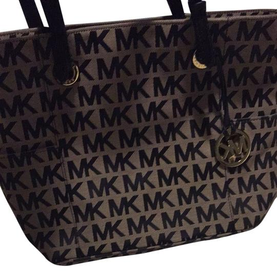 Preload https://item1.tradesy.com/images/michael-kors-mk-black-and-tan-fabric-leather-tote-3584785-0-0.jpg?width=440&height=440