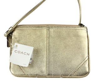 Coach Brass Brass Hardware Metallic Wristlet in Gold