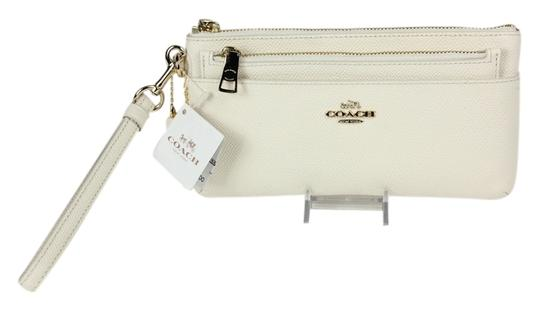 Preload https://item5.tradesy.com/images/coach-52334-double-cream-chalk-leather-wristlet-3605464-0-0.jpg?width=440&height=440