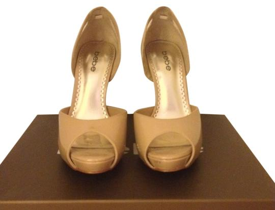Preload https://item1.tradesy.com/images/bebe-nude-carrie-style-number-196729-nde-7-pumps-size-us-7-regular-m-b-361505-0-1.jpg?width=440&height=440