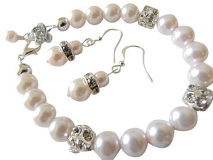 set of earrings and bracelet pink pearl