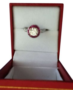 Diamond ring with rubies