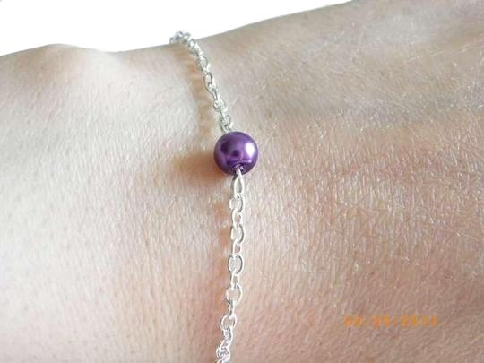 Preload https://item2.tradesy.com/images/red-blue-green-purple-4-of-single-peal-gift-glass-pearl-bracelet-363076-0-2.jpg?width=440&height=440
