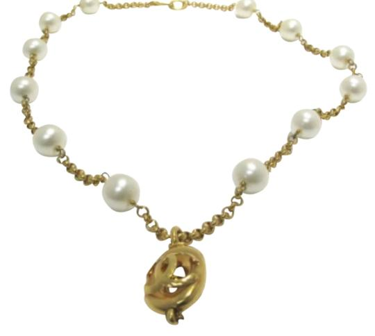 Preload https://item5.tradesy.com/images/chanel-gold-tone-and-pearl-29-necklace-3631309-0-0.jpg?width=440&height=440