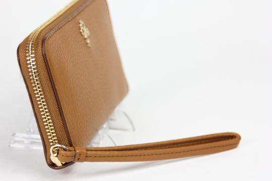 Cole Haan Cole Haan Pebbled Leather Jitney electronic zip around Camello Wristlet - Brown