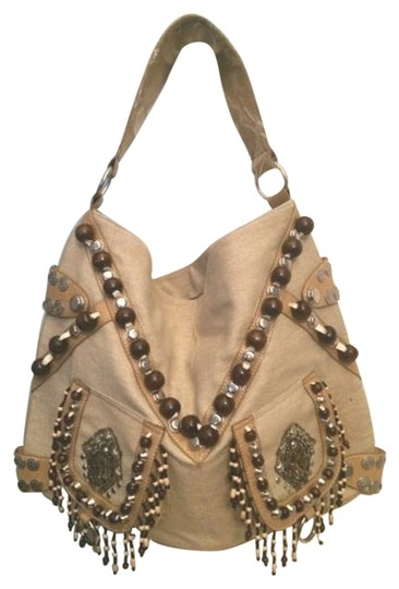 Preload https://item4.tradesy.com/images/handmade-western-style-slouchy-purse-tan-canvas-vinyl-trim-hobo-bag-3635818-0-0.jpg?width=440&height=440