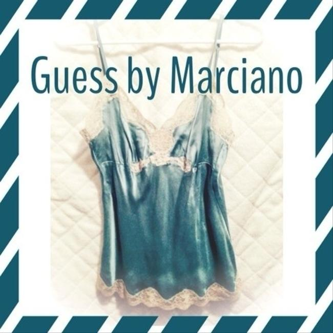 Preload https://img-static.tradesy.com/item/363759/guess-by-marciano-tealblue-tank-topcami-size-4-s-0-0-650-650.jpg