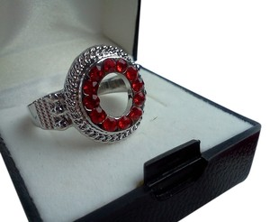 Silver ring with red stone's size 8