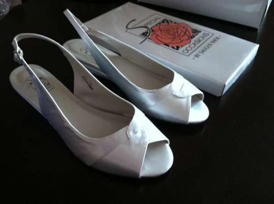 Preload https://item5.tradesy.com/images/special-occasions-by-saugus-shoe-white-low-wedge-sandals-size-us-10-365659-0-0.jpg?width=440&height=440