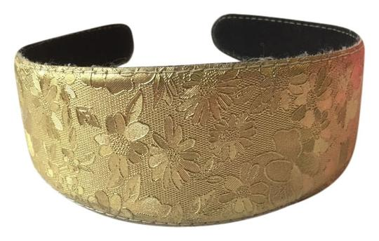 Preload https://item2.tradesy.com/images/gold-flower-imprinted-headband-hair-accessory-3666796-0-0.jpg?width=440&height=440