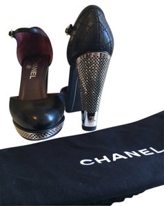 Chanel Perforated Mary Janes Black / Metal Platforms