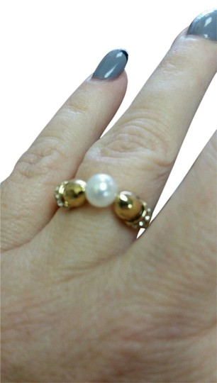 Preload https://item5.tradesy.com/images/yellow-swarovski-elements-pearl-and-crystal-gold-metal-7-adjustable-ring-3694729-0-0.jpg?width=440&height=440