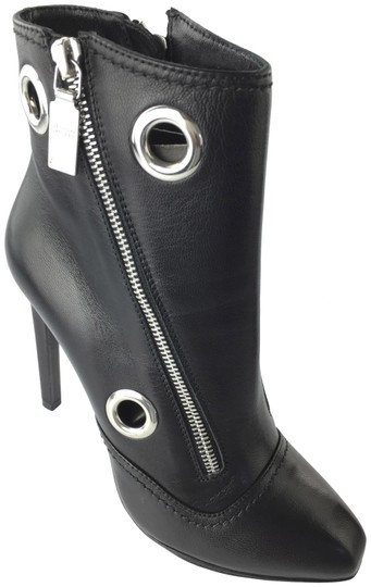 Preload https://item2.tradesy.com/images/alexander-mcqueen-black-grommet-ankle-leather-bootsbooties-size-eu-37-approx-us-7-regular-m-b-3700561-0-2.jpg?width=440&height=440