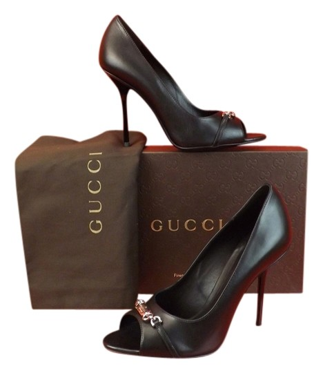 Preload https://item5.tradesy.com/images/gucci-black-leather-metal-plate-logo-peep-toe-high-38-pumps-size-us-8-regular-m-b-3709279-0-0.jpg?width=440&height=440