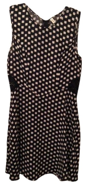 Preload https://item4.tradesy.com/images/pixie-market-black-floral-daisy-dotted-mini-short-casual-dress-size-4-s-370998-0-0.jpg?width=400&height=650