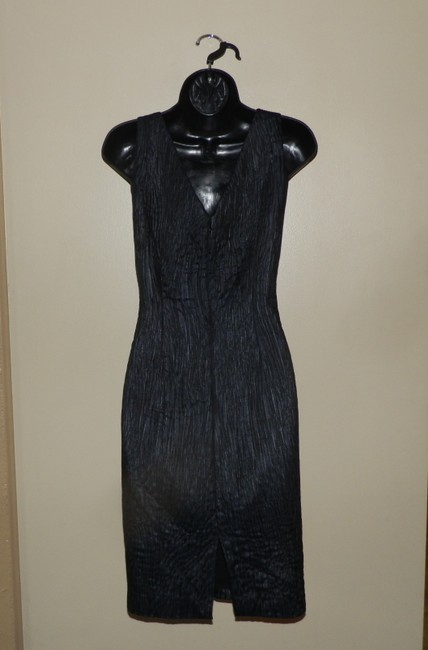 Andrew Marc short dress Black Stretchy Fitted V-neck Lined on Tradesy