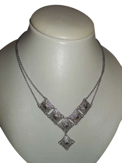 Preload https://item2.tradesy.com/images/sarah-coventry-silver-tone-vintage-filigree-necklace-371901-0-0.jpg?width=440&height=440