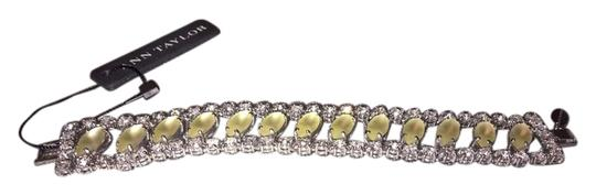 Ann Taylor Gorgeous diamond / silver bracelet with green/yellow stones